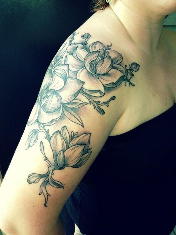 magnolia flower half sleeve tattoo