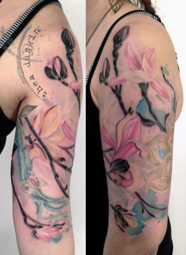 magnolia flower tattoo on half sleeve