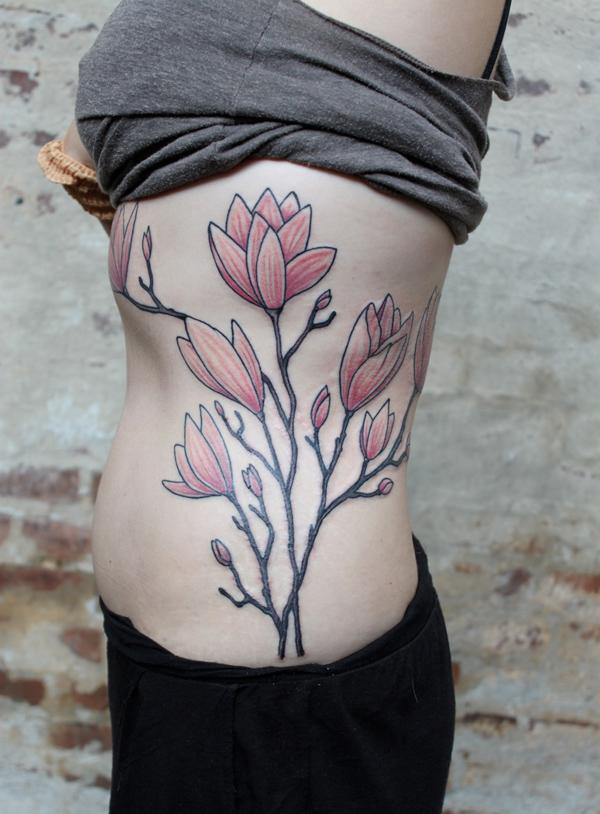 magnolia side tattoo