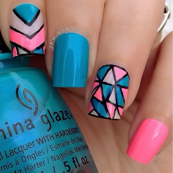 Unleash your artistic tendencies with this abstract blue themed nail art  design. - 50 Blue Nail Art Designs Art And Design