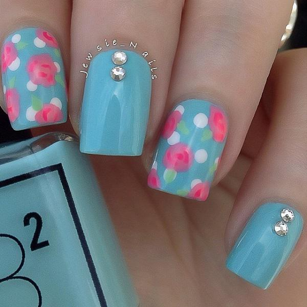 Blue floral themed nail art design. This nail art uses light blue polish is  used ... - 50 Blue Nail Art Designs Art And Design