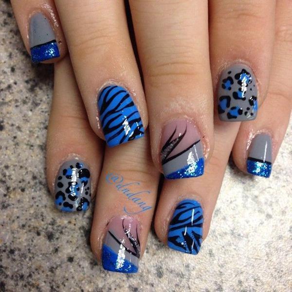 Flashy animal prints nail art design. The all blue themed nail art design  also sport ... - 50 Blue Nail Art Designs Art And Design