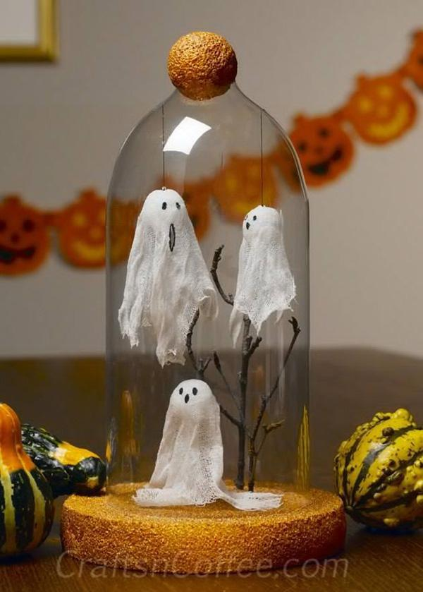 a very creative miniature design of ghosts spooking you out on halloween
