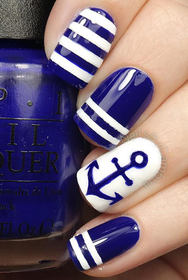 Conquer the anchors with this blue and white nail art design. - 50 Blue Nail Art Designs Art And Design