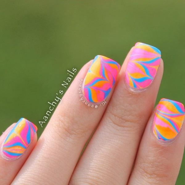 Pink orange and blue watermarble nails-15