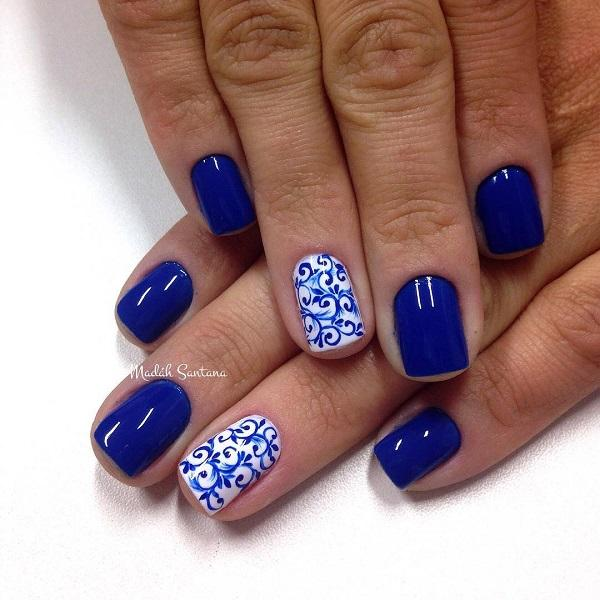 Intricate tribal themed nail art design. This design uses blue and white  polish as base ... - 50 Blue Nail Art Designs Art And Design