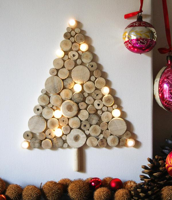 A rather quirky yet very creative Christmas tree made out of chopped wood. : christmas decorations designs ideas - www.pureclipart.com