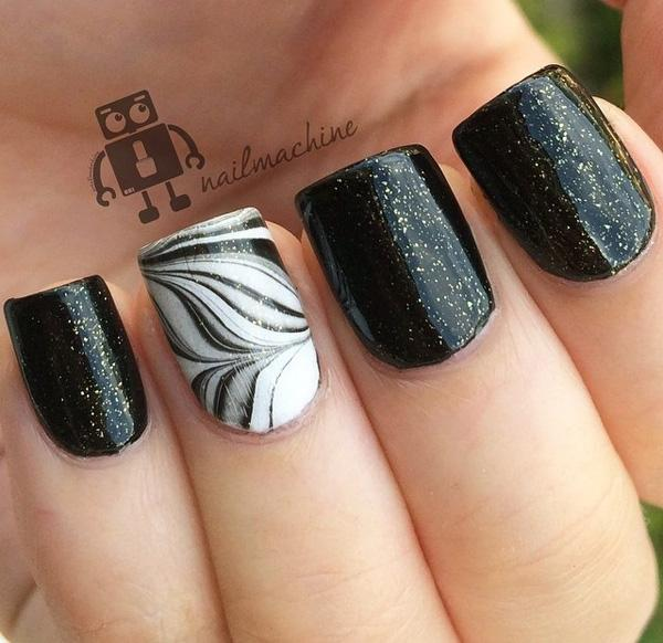 Beautiful Black Feather Nail Art Design Combined With A Sandwich Gold Glitter Paint