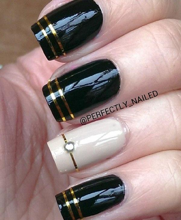Black and white nail art design with gold stripes and embellishments. - 40 Black Nail Art Ideas Art And Design