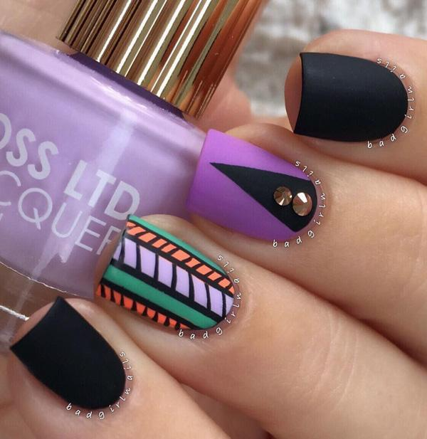Black and purple with tribe nail art