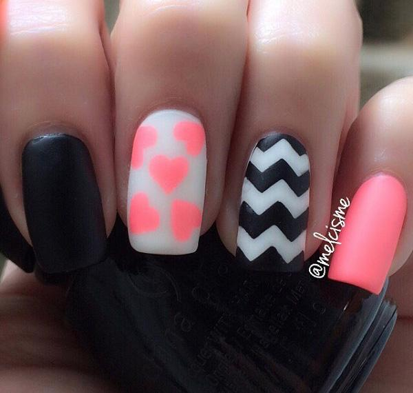 Really interesting looking winter nail art in black, white and pink polish. - 65 Winter Nail Art Ideas Art And Design