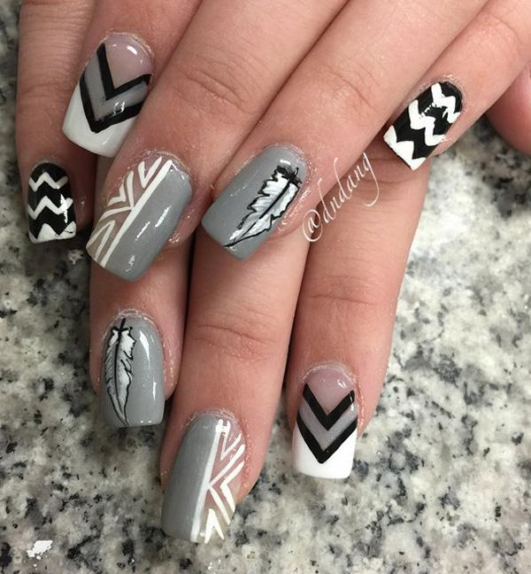 Gary and white feather nail art