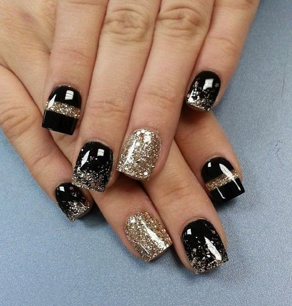 Gold glitter and black nail art for winter