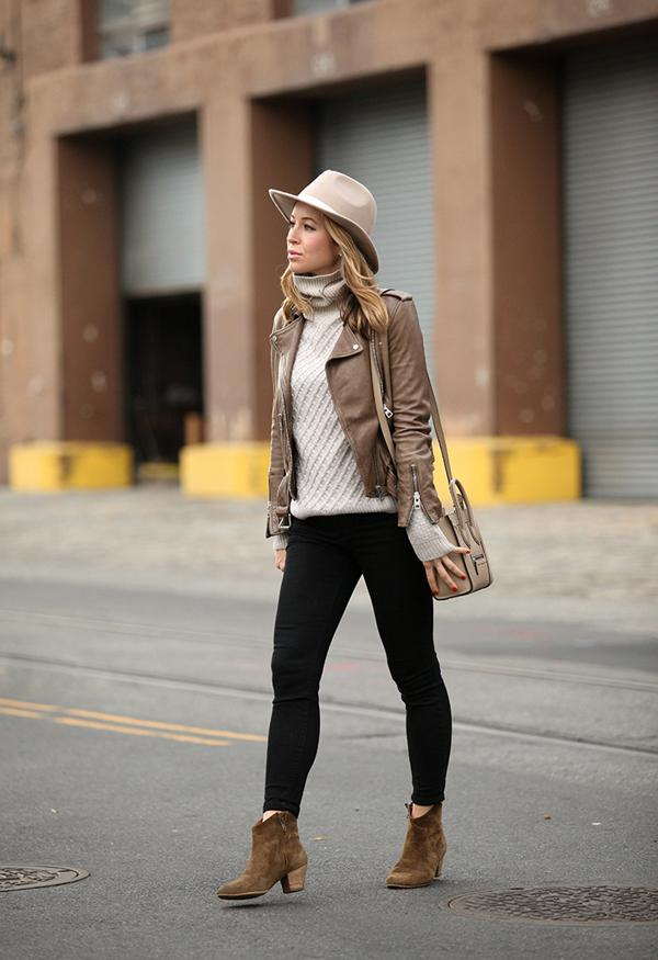 Helena Glazer looks ultra cool in a pair of suede boots, skinny jeans, and an authentic tan leather jacket.