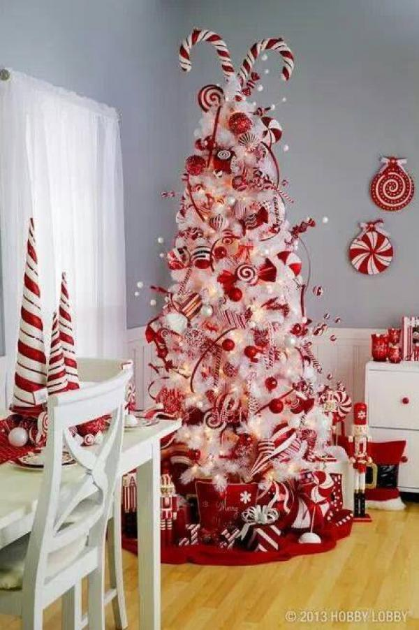 festive red and white candy cane christmas tree go all out this season with this - Candy Themed Christmas Decorations