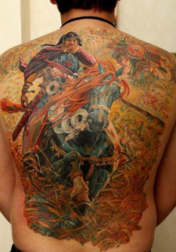 colored warrior with horse full back tattoo