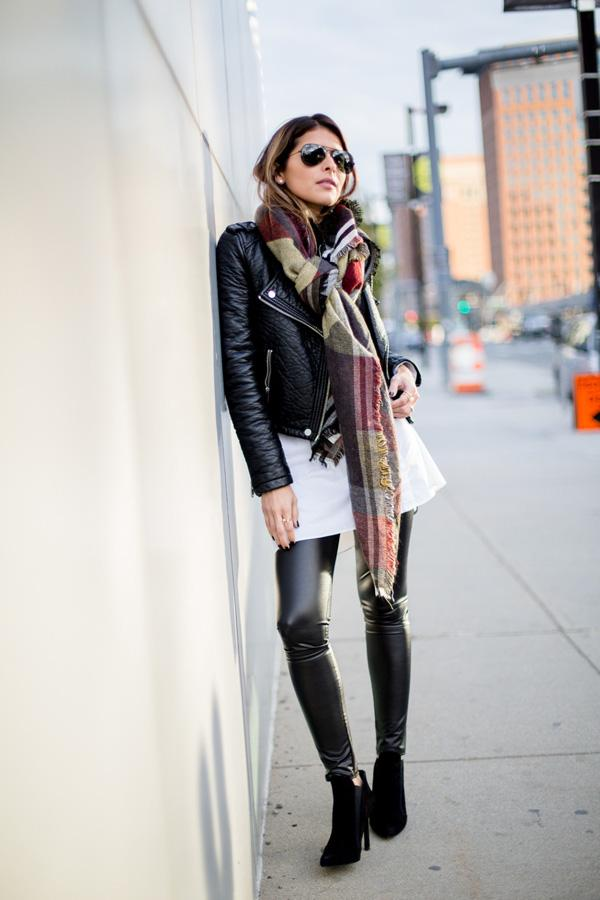 dares to wear leather on leather in a badass leggings and jacket combo.
