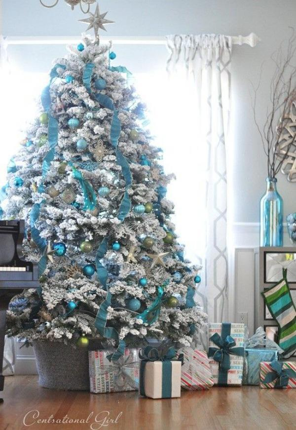 really pretty white and blue themed christmas tree decorate your tree in striking blue ornaments - Teal And Gold Christmas Decorations