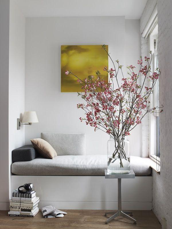 pink flowers in beige and gray room combination the long stemmed pink flowers simply stand