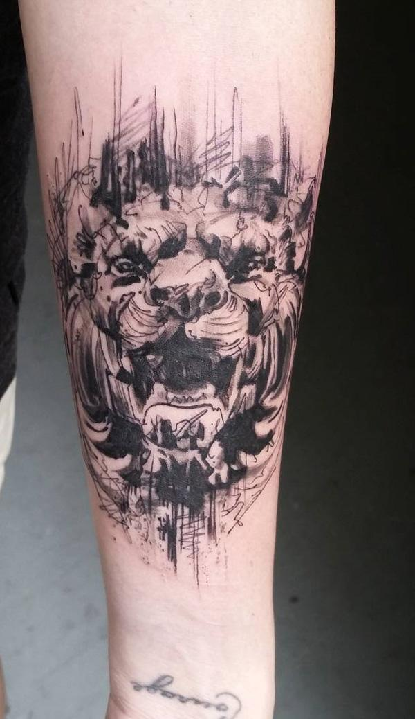 surrealized lion face tattoo