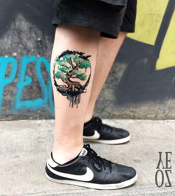 Watercolor tree calf tattoo-13