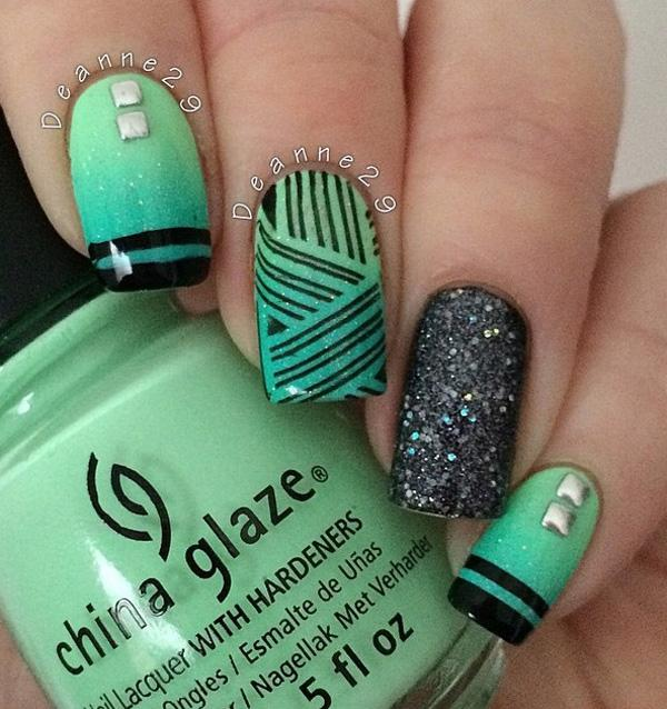 Here's another green and black combo for trendsetters and stylish girls. - 45 Refreshing Green Nail Art Ideas Art And Design