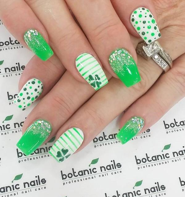 Mix clover leaves, polka dots and glitters and you will have a whole  ensemble of ... - 45 Refreshing Green Nail Art Ideas Art And Design