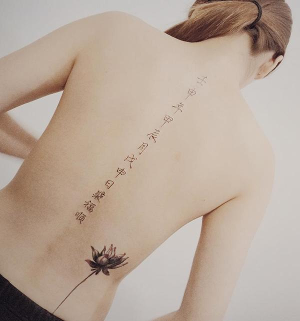 Fonts and lotus spine tattoo-22