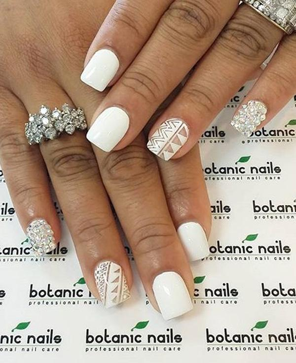 Afraid of overdoing a design? Well you can have it on one nail such as ... - 50 White Nail Art Ideas Art And Design