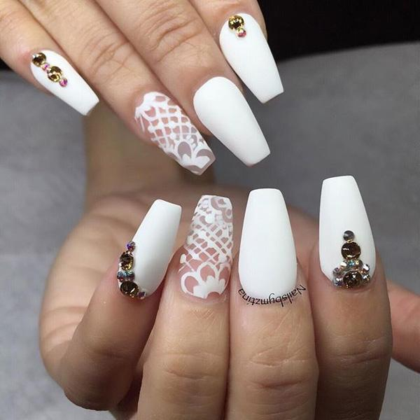 If you're up for an elegant piece, diamonds and graceful patterns will do  ... - 50 White Nail Art Ideas Art And Design