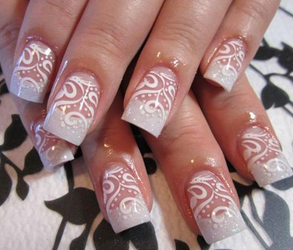 You can see stencils of these swirls for a more synchronized look. - 50 White Nail Art Ideas Art And Design