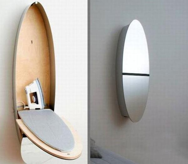 ironing board with mirrored door and small storage