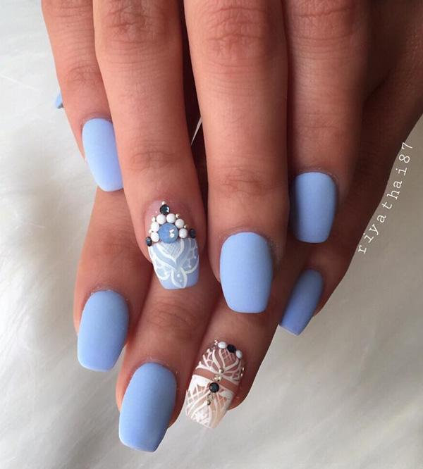 this beautiful sky blue nail polish with white patterns and beads is divine - Nail Polish Design Ideas