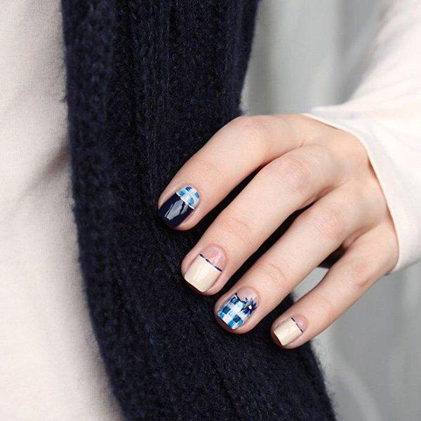This chic and fun design uses different shades of blue for a plaid look. - 50 Half Moon Nail Art Ideas Art And Design