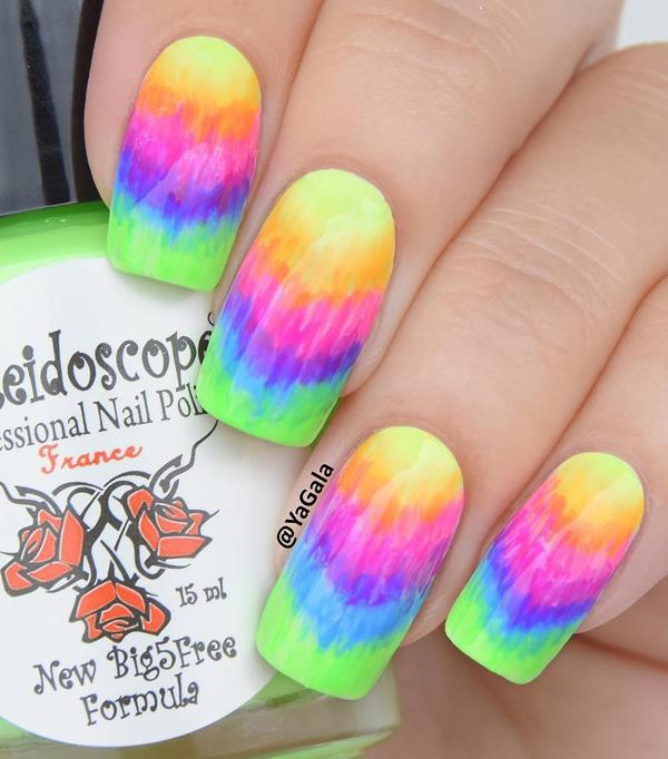 you can try this rainbow nail art design which kinda resembles a tie-dye  shirt ... - 30+ Rainbow Nail Art Ideas Art And Design