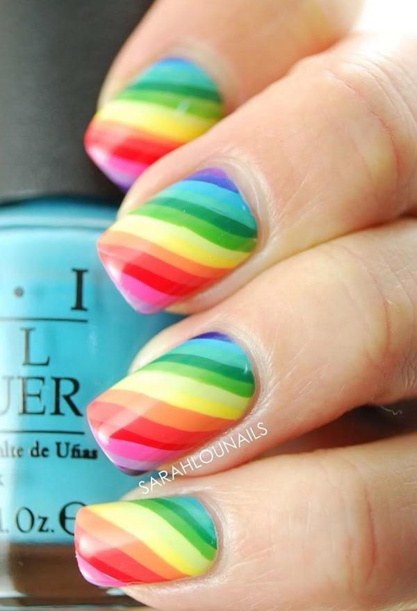 The classic rainbow strips will never go out of style. You can choose  lighter shades ... - 30+ Rainbow Nail Art Ideas Art And Design