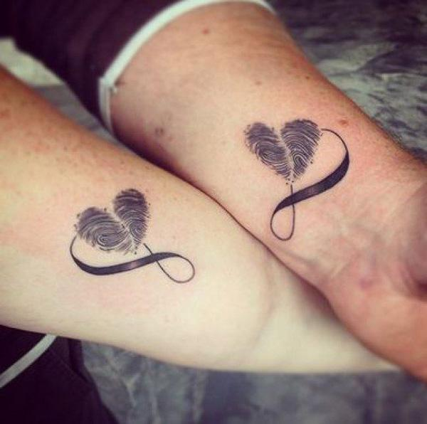 Couple With Matching Infinity Hearts Tattoo On Wrist