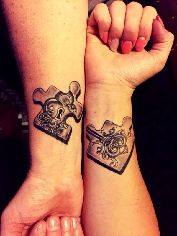 Wonderful looking couple tattoo in puzzle shapes. Just like jigsaw puzzles, there are puzzle