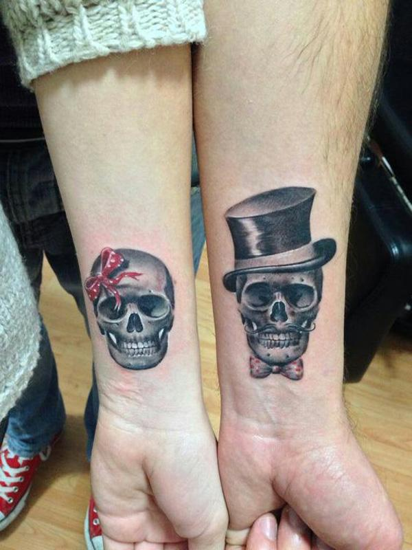 Matching Skull Tattoos On Couple Wris