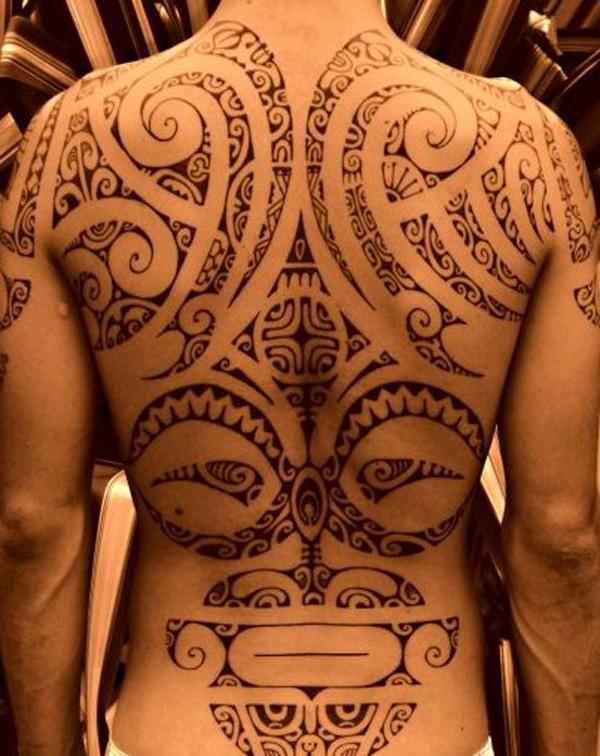 Ornate Maori Tattoo with spirals and tribal shapes designs
