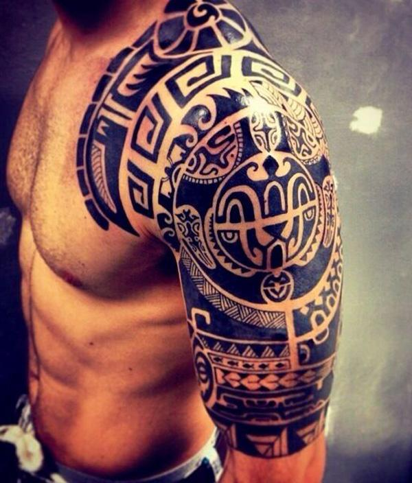 The Traditional Pacific Islander Tattoo Design covers the top half of the wearer's arm and extends onto his chest and back.