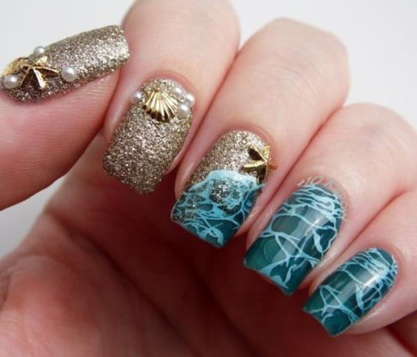 Decoration like sea foam and golden gel that resembles the sand. - 45 Ocean Nail Art Ideas Art And Design
