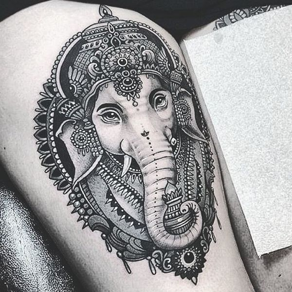 9 Alluring elephant head tattoo on the thigh