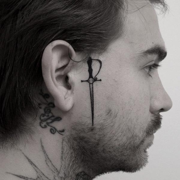 sword tattoo on face-39