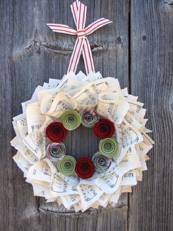 music-wreath-for-christmas-with-red-and-green-flowers