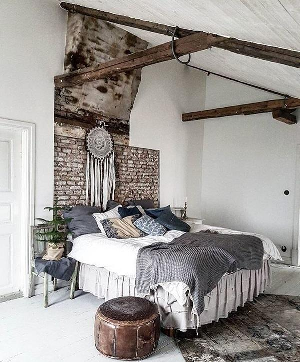 head of the bed is made of brick which looks very old - Rustic Interior Design Ideas