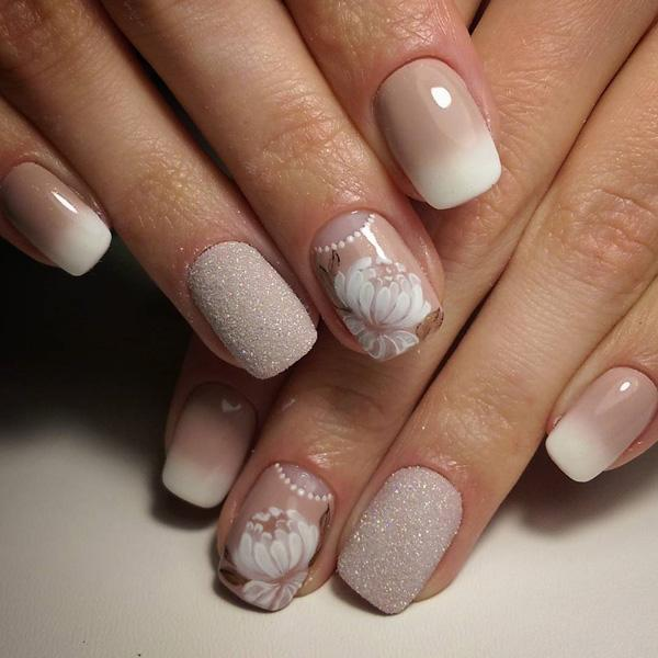 French manicure done by applying ombre technique and enriched with sticker  of roses and sparkling sequins ... - 45 Chic Classy Nail Designs Art And Design