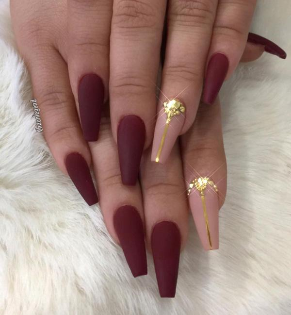 Beige color on forefinger with golden detail, has nice influence on other  matte red nails ... - 45 Chic Classy Nail Designs Art And Design