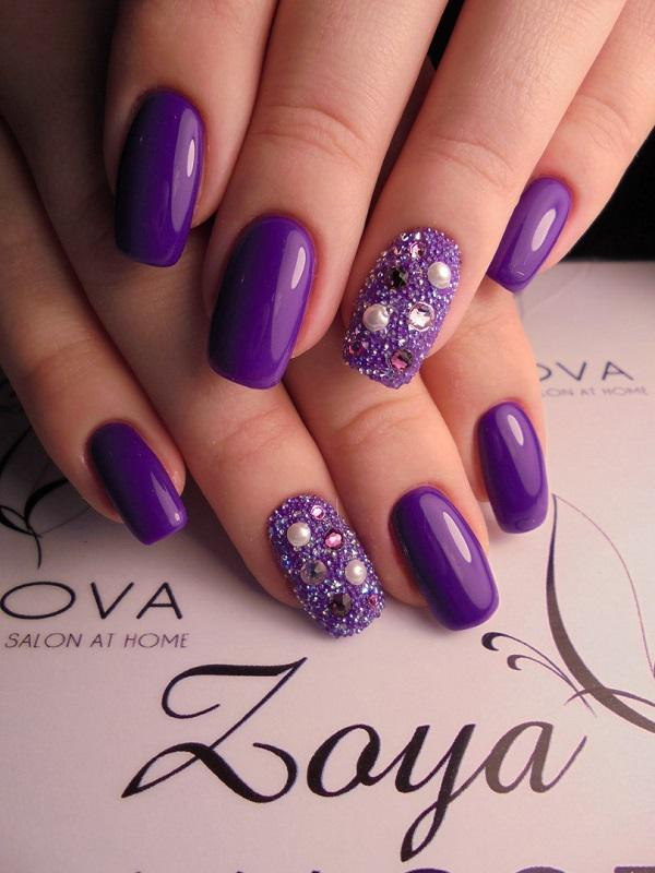 This lady also have chosen royal purple shade and complement it with the  various rhinestones! - 45 Purple Nail Art Designs Art And Design