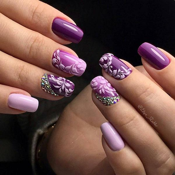 For the decoration of this manicure is selected embossed elegant patterns  in a very bright purple ... - 45 Purple Nail Art Designs Art And Design